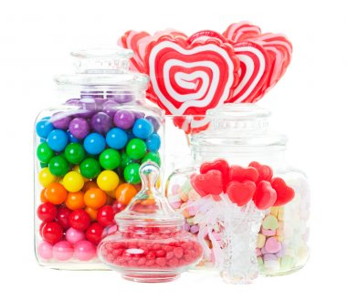 A display of various candies in glass containers. Shot on white background. stock vector