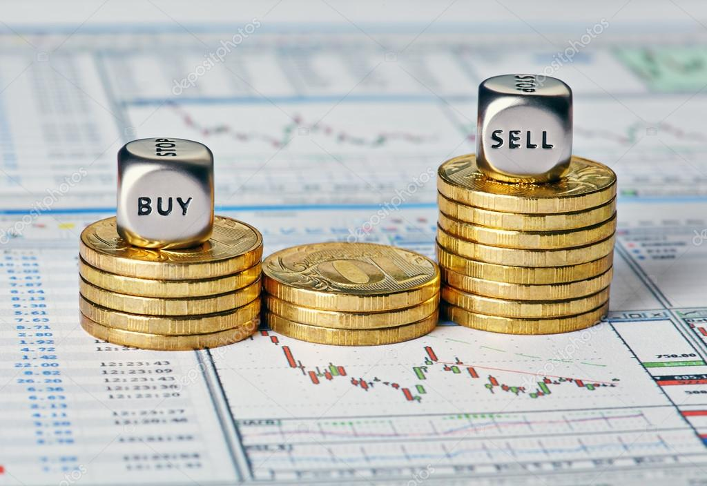 Financial chart, coins and dice cubes with the words Sell Buy. S
