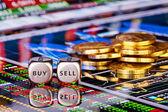Würfel mit den Worten sell buy, golden coins und financial