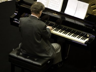 Senior man playing the piano