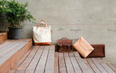 Fotografie Fashion Leather Bags on grunge background