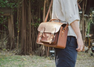 Man with brown leather bag
