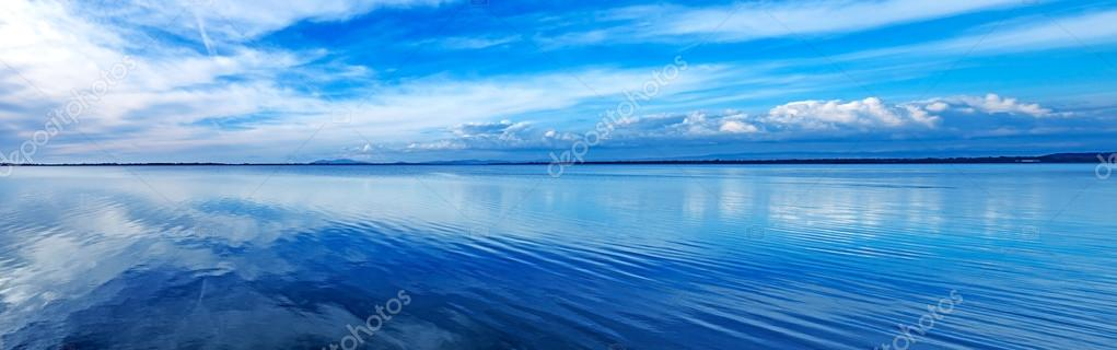 Sunset blue panoramic landscape. Orbetello lagoon, Argentario, Italy.
