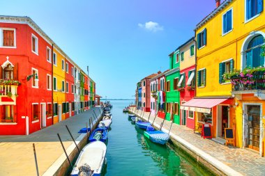 Venice landmark, Burano island canal, colorful houses and boats, Italy. Long exposure photography stock vector