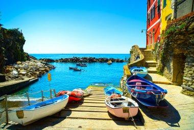 Riomaggiore village street, boats and sea. Cinque Terre, Ligury,
