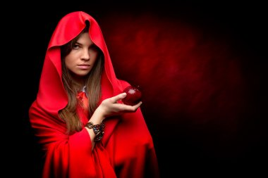 beautiful woman with red cloak holding apple