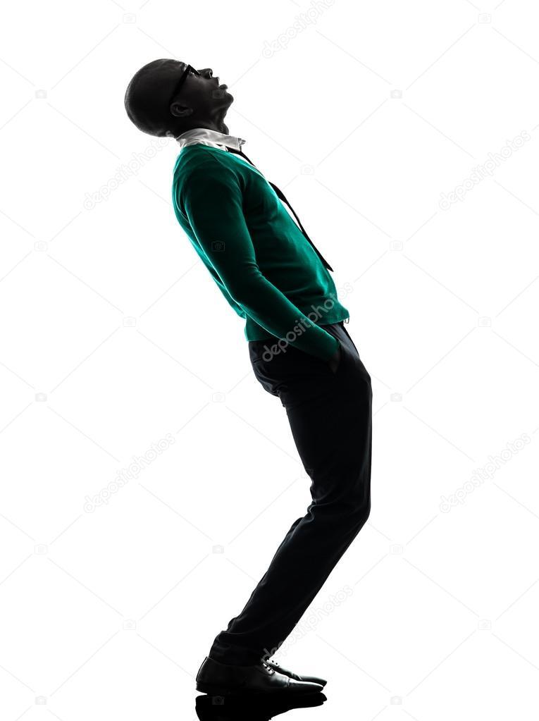 homme noir africain debout regardant vers le haut de la silhouette surprise photo 30741843. Black Bedroom Furniture Sets. Home Design Ideas