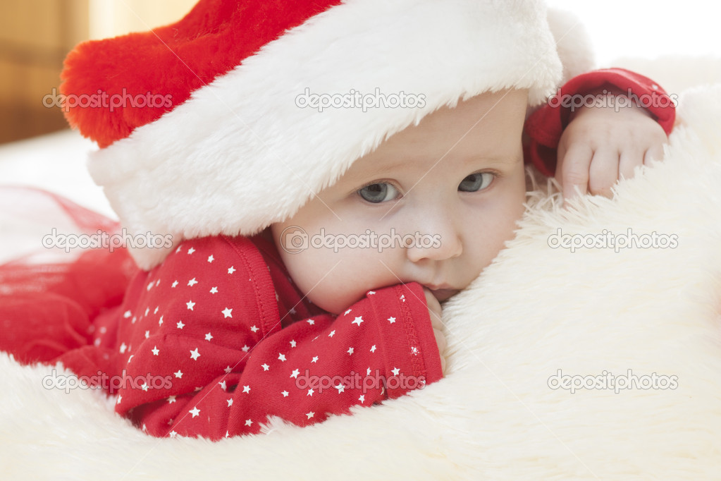 7ee9360c98e Cute Baby girl in christmas hat — Stock Photo © Aksakal  19329005