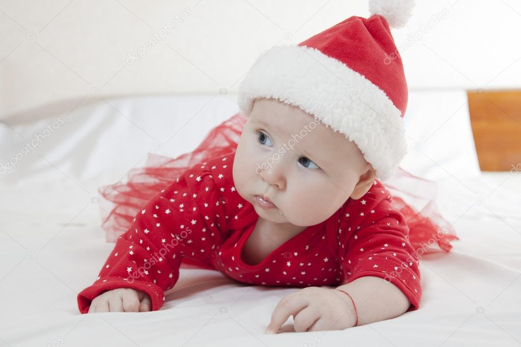ebfb1fa13e7b Cute Baby girl in christmas hat — Stock Photo © Aksakal  19353495