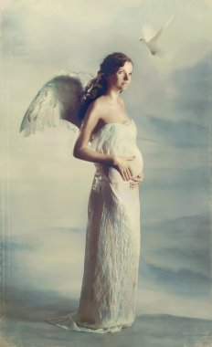 Beautiful young pregnant girl with angel wings with dove.