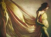 krásná těhotná žena v mávat tkaniny