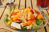 Fotografie Salad with tropical fruit and chicken