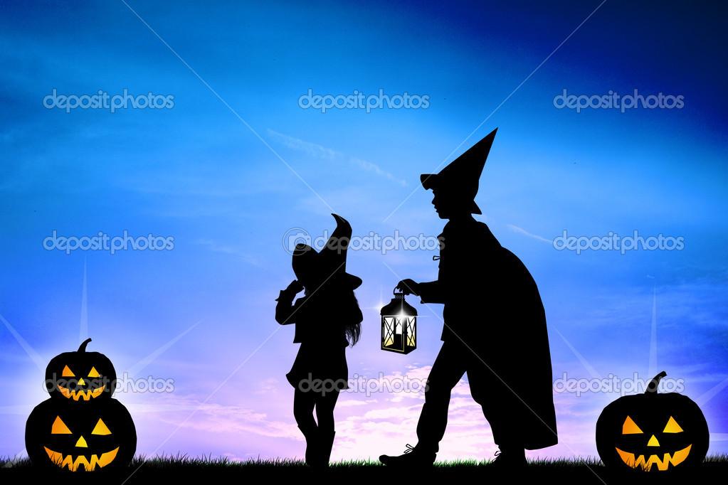 Children wearing masks at Halloween