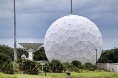 Launch Tracking Station with Geodesic Radome Against a Darkening Sky