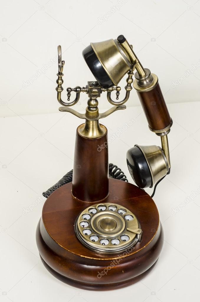 Old fashioned telephone isolated on white background  Studio