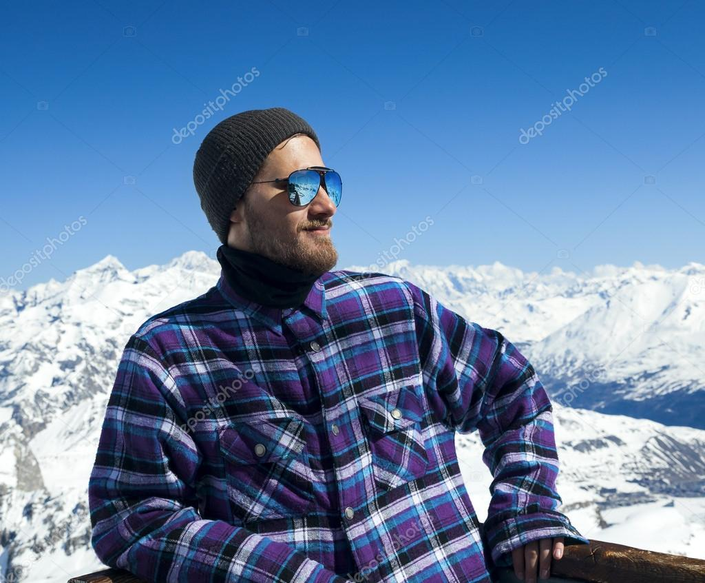Portrait of smiling man at ski resort