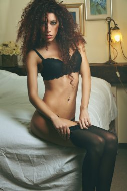 Lingerie sensual woman dressing on bed