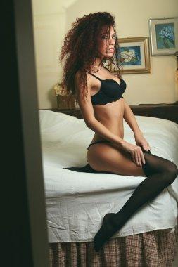 Voyeur portrait of a sensual woman