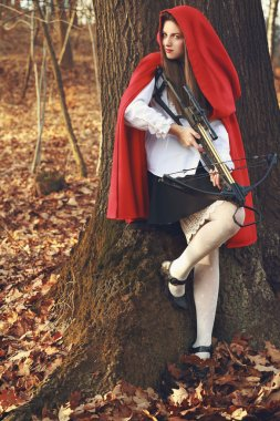 Little red riding hood waits her prey