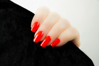 woman's hand with red nails