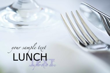 Fork and knife in elegant table setting, with copyspace
