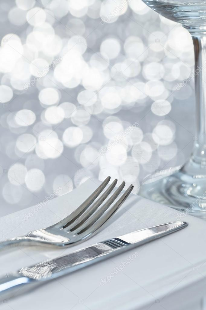 Table Setting Background fork and knife in elegant table setting with festive background