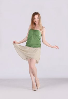 girl  in green undershirt and beige skirt