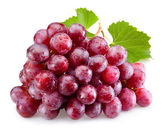 Ripe red grapes with leaves isolated