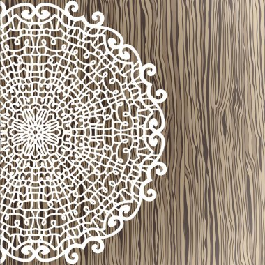 Openwork napkin on wooden background