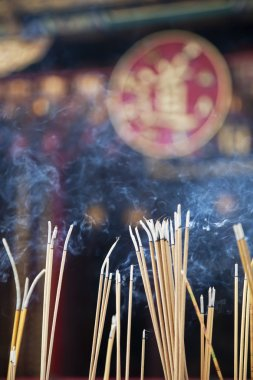 Incense left burning  by worshipers at Wong Tai Sin Temple. Also known as Sik Sik Yuen Wong Tai Sin Temple, is a Taoist Temple is located in Kowloon, Hong Kong, China
