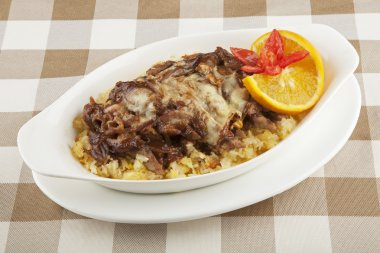 Beef and rice severed covered with a delicious sauce