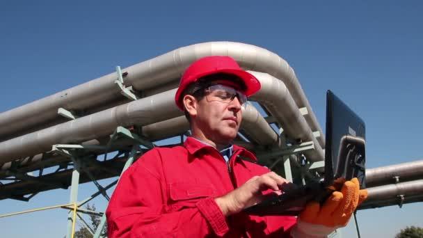 Petrochemical Engineer Using Laptop