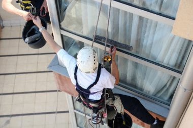 Climbers Washing Windows