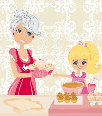 Grandma baking cookies with her granddaughter