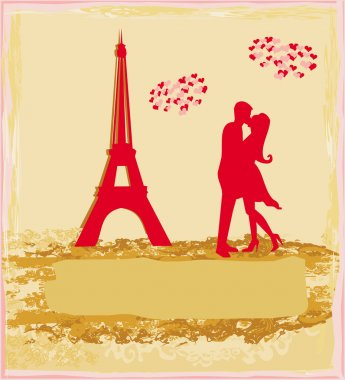 Romantic couple silhouette in Paris kissing near the Eiffel Tower.