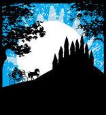 silueta koňským povozem a středověký hrad