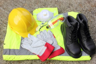 A collection of Personal protection equipment that is available for the health and safety of all personel stock vector