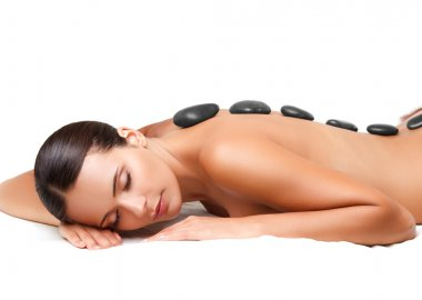 Stone Massage. Beautiful Woman Getting Spa Hot Stones Massage. S