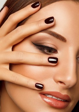 Beautiful Woman With Red Nails. Makeup and Manicure. Red Lips