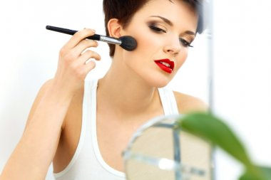 Beauty Girl with Makeup Brush and Red Lips