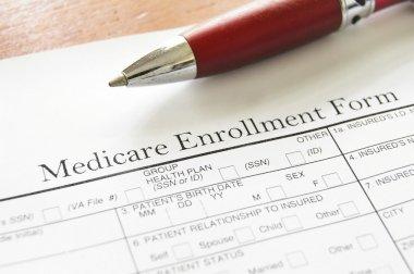 Closeup of Medicare enrollment form and pen stock vector
