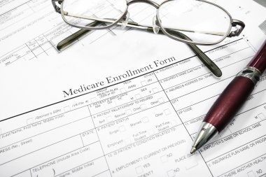Medicare insurance form with glasses and pen stock vector
