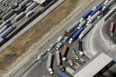 Trucks lined up waiting to cross into the U.S. from Tijuana, Mexico.