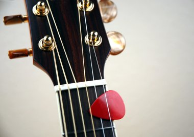 Guitar with a pick