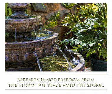 A decoratie stone fountain in a garden and quote about Serenity