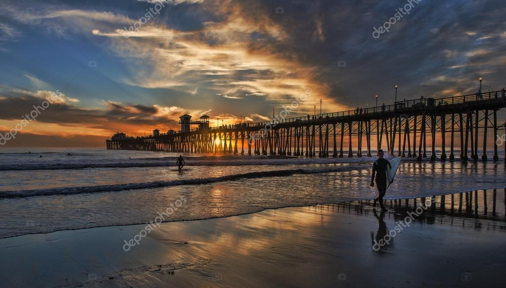 Surfers Walking Out Oceanside Pier Sunset