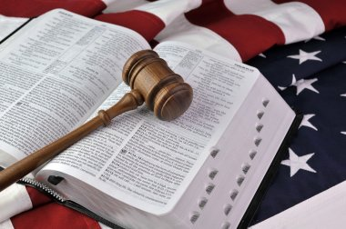 Wooden gavel, Bible, and flag