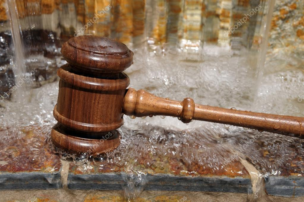 Wooden Gavel and flowing water