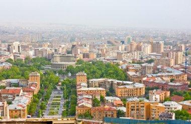 YEREVAN, ARMENIA, JUNE, 23: City Yerevan, mountain ridge of Caucasus,Armenia on June,23,2012. View of the Opera and Ballet Theatre, avenue and the buildings