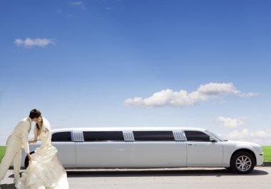 White car. wedding kiss